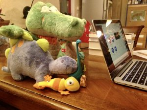Plush reptile stand-in audience at online reading